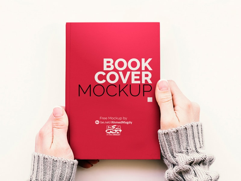 Free Hand Holding Book Cover Mockup