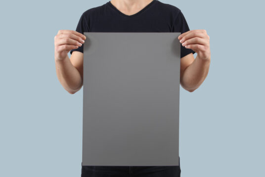 Hands holding a Poster Mockup