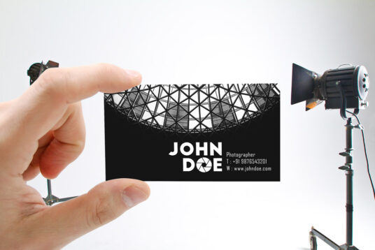 Male Hand holding Business Card Mockup